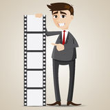 Cartoon businessman presentation with photographic film Stock Photos