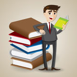 Cartoon businessman reading with stack of book Royalty Free Stock Image