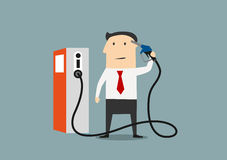 Cartoon businessman refuelling his brain. Businessman refuelling his brain from a pump marked with an icon for information and knowledge, or price of gasoline Stock Photo