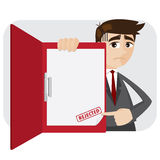 Cartoon businessman showing rejected document in folder Stock Photo