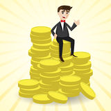 Cartoon businessman sitting on stack of gold coin Royalty Free Stock Photo