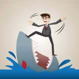 Cartoon businessman standing on shark Royalty Free Stock Photo