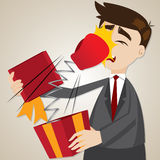 Cartoon businessman with surprise gift box Stock Image