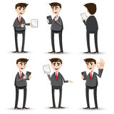 Cartoon businessman with tablet set. Illustration of cartoon businessman with tablet set Stock Images