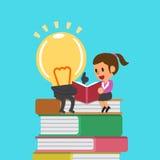 Cartoon businesswoman and big idea reading a book Stock Photo