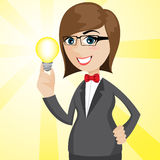 Cartoon businesswoman with shiny idea bulb. Illustration of cartoon businesswoman with shiny idea bulb Royalty Free Stock Photography