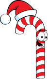 Cartoon candy cane wearing a Santa Hat Royalty Free Stock Images