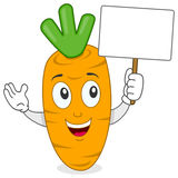 Cartoon Carrot Holding a Blank Banner Royalty Free Stock Photography