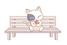 Cartoon cat sitting and eating ice cream Stock Photography