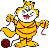 Cartoon cat tangled in yarn. Royalty Free Stock Image