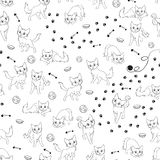 Cartoon cats seamless pattern. Funny cartoon cats and their accessories, seamless black and white vector pattern Royalty Free Stock Images