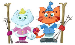 Cartoon cats with skis Royalty Free Stock Photography