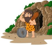 Cartoon caveman inventing stone wheel with cave background. Illustration of Cartoon caveman inventing stone wheel with cave background Royalty Free Stock Images