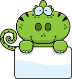 Cartoon Chameleon Sign. A cartoon illustration of a chameleon with a white sign Stock Photo