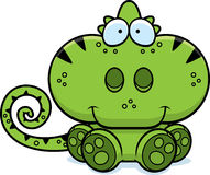 Cartoon Chameleon Sitting. A cartoon illustration of a chameleon sitting and smiling Stock Photos