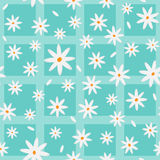 Cartoon chamomiles and petals. Floral elements scattered on a checkered background. Seamless pattern. Royalty Free Stock Image