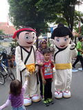 Cartoon character costumes. People with a cartoon character costumes entertain visitors on a street in the city of Solo, Central Java, Indonesia Royalty Free Stock Photos