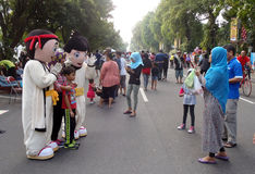 Cartoon character costumes. People with a cartoon character costumes entertain visitors on a street in the city of Solo, Central Java, Indonesia Stock Photo