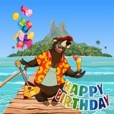 Cartoon character happy bear happy birthday at sea in the tropics Royalty Free Stock Image