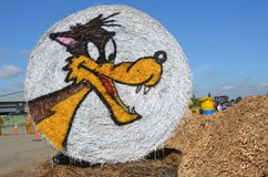 Cartoon character painted on a rolled hay bale for Halloween. This is a cartoon character painted on a rolled hay bale for Halloween against a blue sky.  It is Stock Images