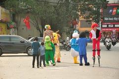 Cartoon characters. Vietnamese men dressed up in costumes on a street in Hanoi Vietnam stock photo