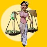 Cartoon cheerful Vietnamese woman walks with fruit baskets Stock Photos