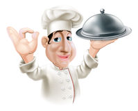 Cartoon chef with serving tray. Illustration of a cartoon friendly happy chef with silver serving tray smiling and doing okay sign Royalty Free Stock Photography