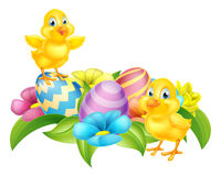 Cartoon Chicks and Easter Eggs Stock Photos