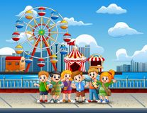 Cartoon of Children having fun on the lakeside with amusement park background. Illustration of Cartoon of Children having fun on the lakeside with amusement park stock illustration