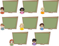 Cartoon children reading books over green chalkboard blackboard. Stock Photo