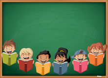 Cartoon children reading books over green chalkboard blackboard. Stock Photos