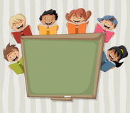 Cartoon children reading books over green chalkboard blackboard. Stock Photography