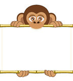 Cartoon chimpanzee cub holding a blank sheet of paper. Cute cartoon chimpanzee cub holding a blank sheet vector. All elements sorted and grouped in layers Stock Photo