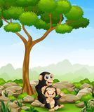 Cartoon chimpanzee mother hug her baby chimp in the jungle Royalty Free Stock Photography