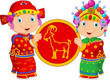 Cartoon Chinese kids holding goat symbol Stock Images