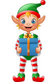 Cartoon Christmas elf holding gift box Royalty Free Stock Photography