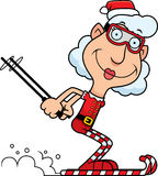 Cartoon Christmas Elf Skiing. An illustration of a cartoon Christmas elf grandma skiing on candy canes royalty free illustration