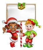 Cartoon Christmas Elves Holding Sign Stock Photos