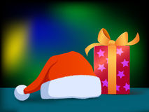 Cartoon christmas hat and gift box Royalty Free Stock Image