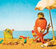 Cartoon clay octopus at the beach on summer holidays. A cartoon clay octopus at the beach in a warm day having vacations and doing many things at the same time Royalty Free Stock Image
