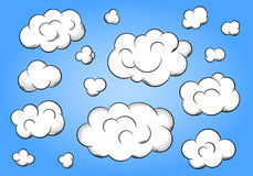 Cartoon clouds on blue background Royalty Free Stock Photography