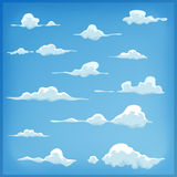 Cartoon Clouds Set On Blue Sky Background. Illustration of a set of funny cartoon clouds, smoke patterns and fog icons, for filling your sky scenes or ui games Royalty Free Illustration