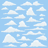 Cartoon Clouds Set On Blue Sky Background. Set of funny cartoon clouds, smoke patterns and fog icons, for filling your Royalty Free Stock Image