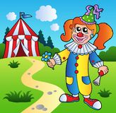 Cartoon clown girl with circus tent Royalty Free Stock Photo