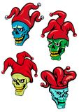 Cartoon clown and joker skulls. Cartoon clown or joker skull with hat, bells and eyes. For Halloween, t-shirt  and tattoo design Royalty Free Stock Image