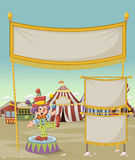 Cartoon clown juggling in front of cartoon circus. Stock Image