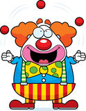 Cartoon Clown Juggling. A happy cartoon clown juggling and smiling Royalty Free Stock Image