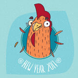 Cartoon cock or rooster smiles in round frame. Close-up of cartoon playful cock or rooster smiles in round frame on blue background. New Year 2017 lettering Stock Photography