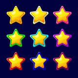Cartoon colorful glossy Star. Vector illustration. Set of Cartoon Stars.Cartoon colorful glossy Star in different colors isolated on a dark background.Game icon Royalty Free Stock Photo