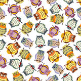 Cartoon colorful owls seamless pattern background. Cartoon seamless pattern of colorful owls on tree branches with ornamental striped and spotted feathering Stock Images